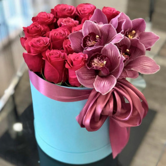 Pink roses and orchids in box photo