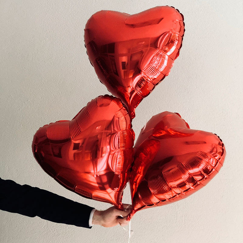 3 red heart balloons photo