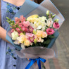 Bouquet of orchids and eustomas photo