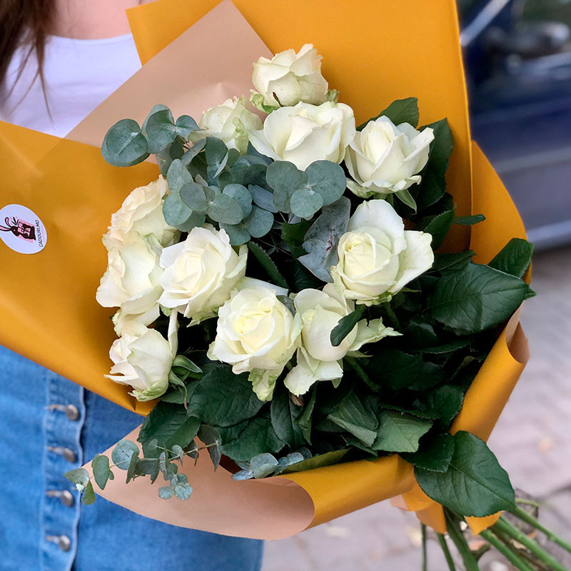 White roses in colorful packaging photo