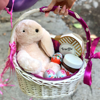 Basket with balloons and rabbit photo