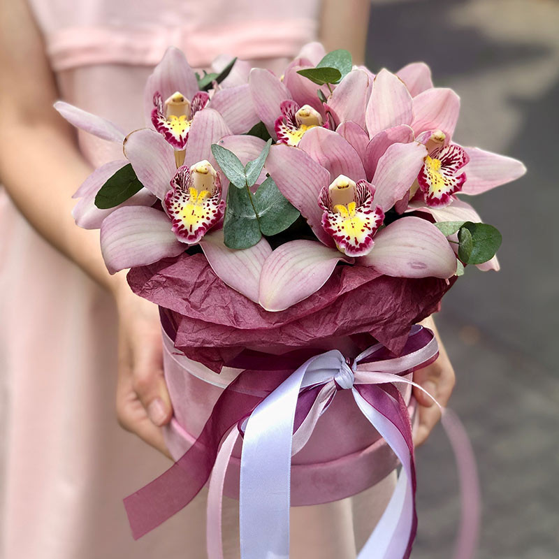 Box of pink orchids photo