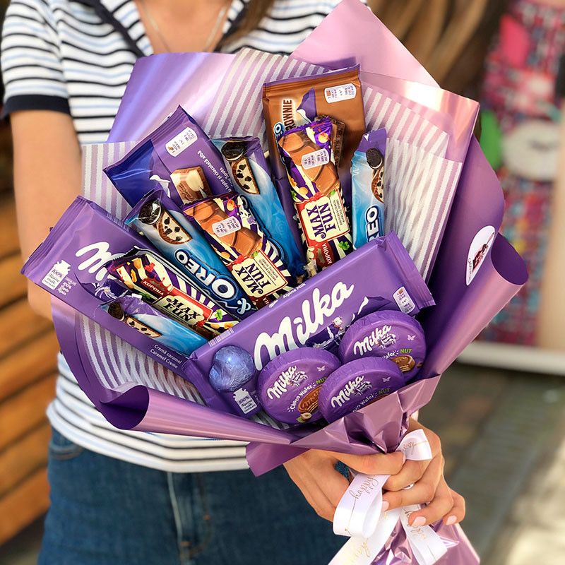 Bouquet with chocolate milka photo