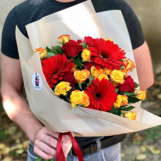 Bouquet of roses and red gerberas photo