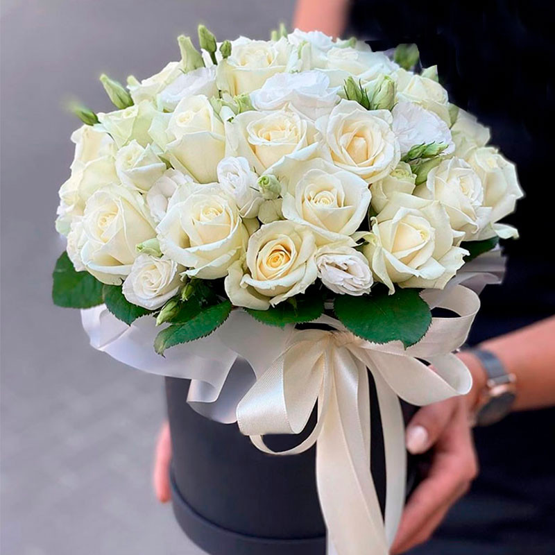 White roses in a black box photo