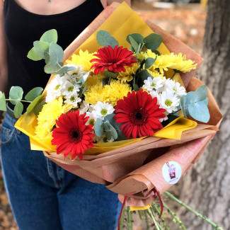 Bouquet of yellow chrysanthemums and gerberas photo