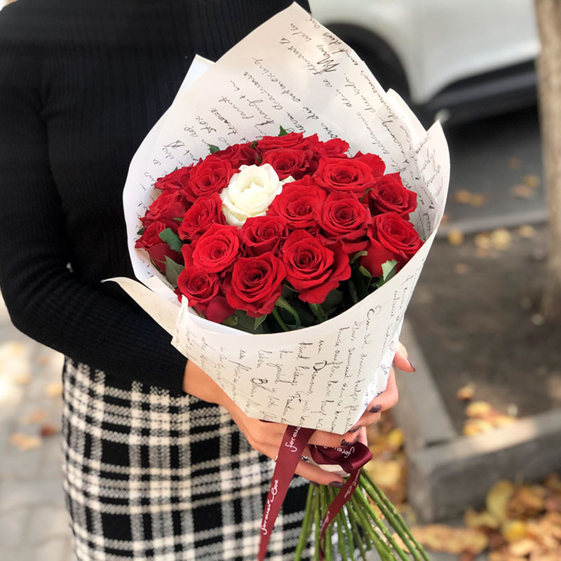 20 red roses and 1 white foto