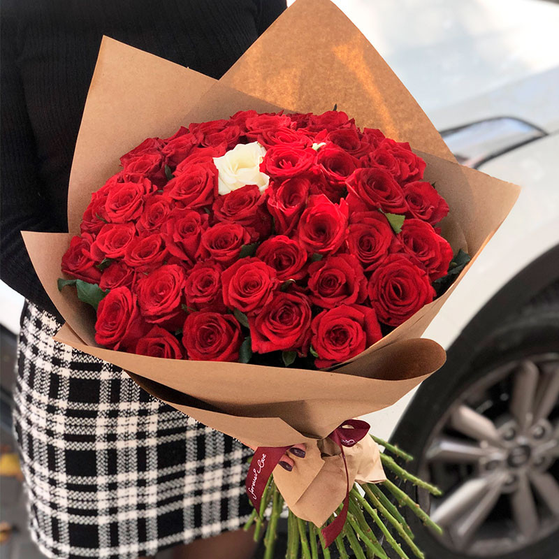 50 red roses and 1 white foto