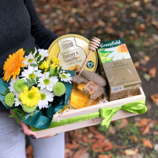 Gift set with chamomile tea and cookies photo
