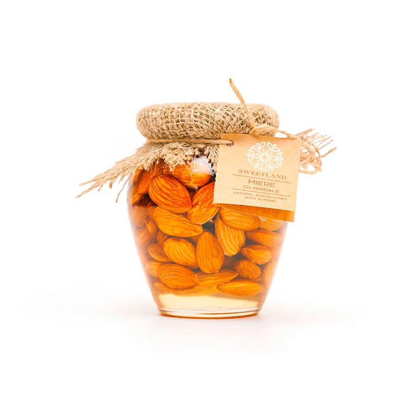 Acacia honey with almonds photo
