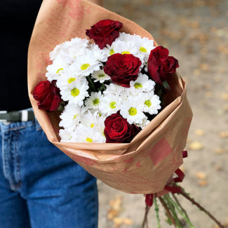 Bouquet of white chrysanthemums with red roses photo