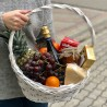 Basket with champagne and fruits photo