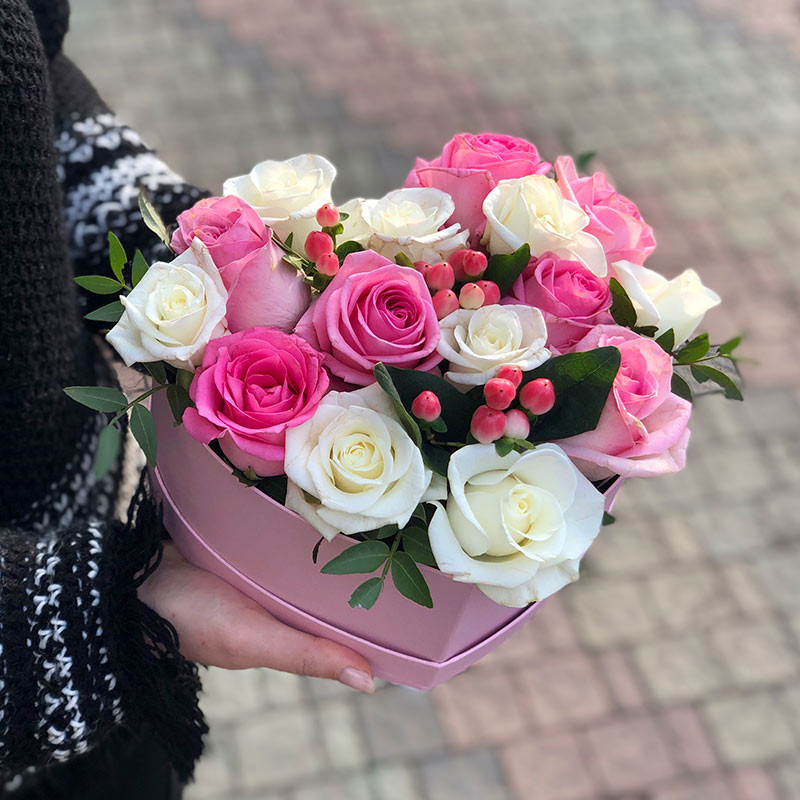 Tender roses in a pink heat box photo