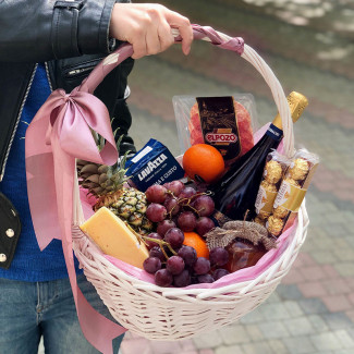 Basket with grapes and cheese photo