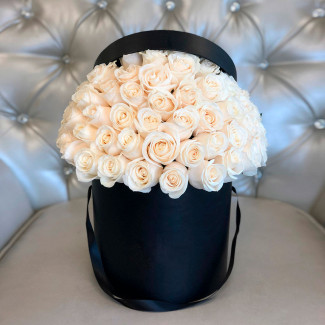49 white roses in black box photo