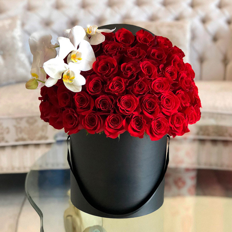 Red roses with white orchid photo