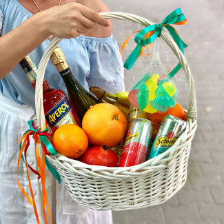 Basket with alcohol and fruit photo